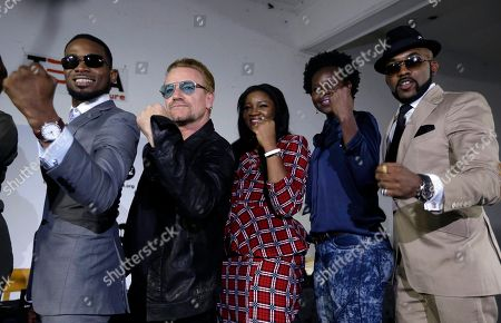"""Irish rock star Bono, second left, poses with African music stars after a press conference in Lagos, Nigeria, African stars and rock star Bono say music can help push for the empowerment of women globally. Bono and the top African male musicians D'banj, Diamond and Banky W announced Friday that they will be included in a remix of the song """"Strong Girl"""" - a rallying cry for women's empowerment which features top African female talent"""