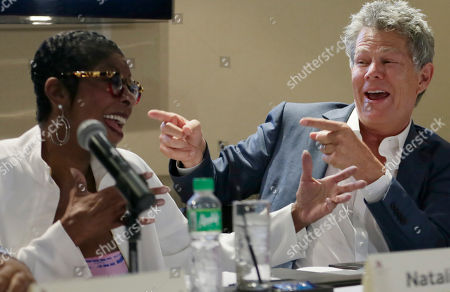 David Foster, Natalie Cole Musician David Foster, right, and singer Natalie Cole, perform an impromptu number during a news conference for their concert at suburban Pasay city, south of Manila, Philippines. Foster will have a one night only concert Tuesday featuring Cole, Ruben Studdard, Boyz II Men, Charice and a new artist Mark Mabasa