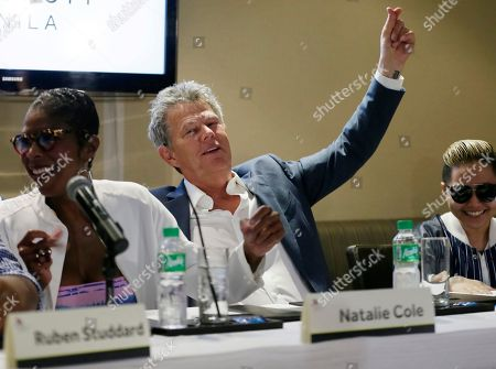 Stock Photo of David Foster, Natalie Cole, Charice Pempengco Musician David Foster, center, singers Natalie Cole, left, and Charice Pempengco perform an impromptu number during a news conference for their concert at suburban Pasay city, south of Manila, Philippines. Foster will have a one night only concert Tuesday featuring Cole, Ruben Studdard, Boyz II Men, Charice and a new artist Mark Mabasa