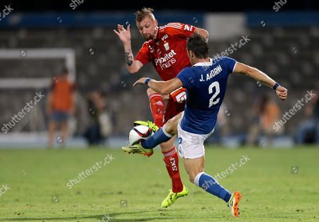Stock Image of Goteborg's Sebastian Eriksson, left, goes for the ball with Belenenses' Joao Amorim during the Europa League third qualifying round, first leg, soccer match between Belenenses and Goteborg at the Restelo stadium in Lisbon