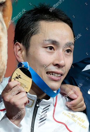 Ota Yuki Ota Yuki, of Japan, shows off his gold medal after winning the foil competition at the fencing World championships in Moscow, Russia, on