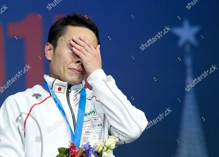 Ota Yuki Ota Yuki, of Japan, reacts on a podium after winning the foil competition at the fencing World championships in Moscow, Russia, on