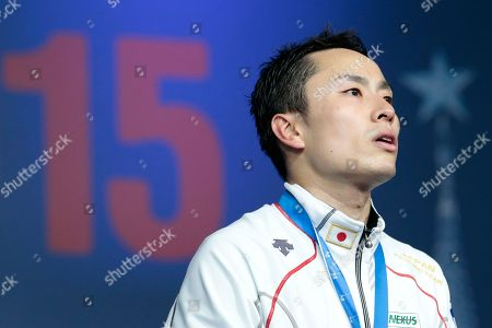 Ota Yuki Ota Yuki, of Japan, listens to the national anthem after winning the foil competition at the fencing World championships in Moscow, Russia, on