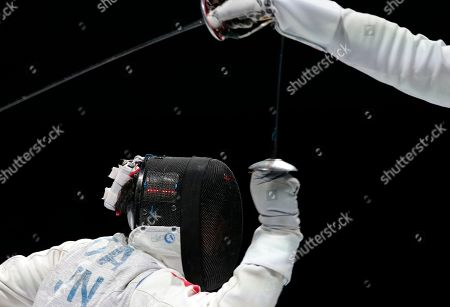 Ota Yuki Ota Yuki, of Japan, bottom, in action against Gerek Meinhardt, of the United States, during their semifinal match at foil competition at the fencing World championships in Moscow, Russia, on