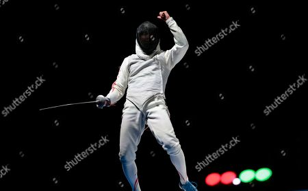 Ota Yuki Ota Yuki, of Japan, reacts after winning the point against Alexander Massialas, of the United States, during the gold medal match at foil competition at the fencing World championships in Moscow, Russia, on