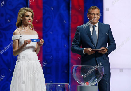 FIFA Secretary General Jerome Valcke, right, looks to presenter and model Natalia Vodianov who holds an 'Asia' lot during the preliminary draw for the 2018 soccer World Cup in Konstantin Palace in St. Petersburg, Russia