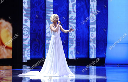 Russian singer Polina Gagarina performs during the preliminary draw for the 2018 soccer World Cup in Konstantin Palace in St. Petersburg, Russia