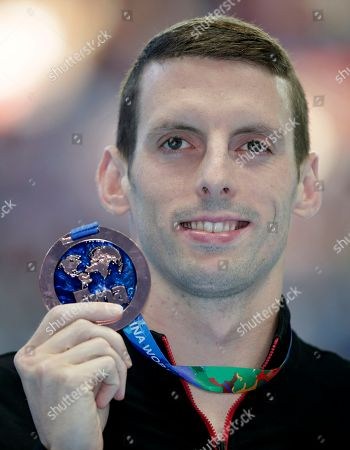 Canada's Ryan Cochrane holds his bronze medal following his third place in the men's 400m freestyle final at the Swimming World Championships in Kazan, Russia