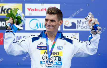 Greece's Spyridon Gianniotis smiles during the ceremony after winning the bronze medal for the men's 10km open water swim competition at the Swimming World Championships in Kazan, Russia
