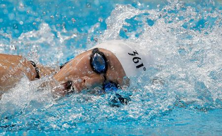China's Ye Shiwen competes in a women's 200m individual medley heat at the Swimming World Championships in Kazan, Russia