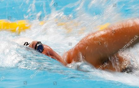 With slow shutter speed Denmark's Lotte Friis competes in a women's 1500m freestyle heat at the Swimming World Championships in Kazan, Russia