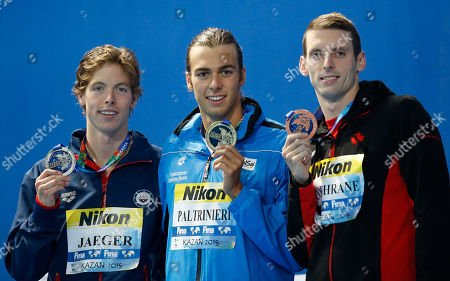 Stock Image of Italy's gold medal winner Gregorio Paltrinieri is flanked by United States' silver medal winner Connor Jaeger, left, and Canada's bronze medal winner Ryan Cochrane waves during the ceremony for the men's 1500m freestyle final at the Swimming World Championships in Kazan, Russia