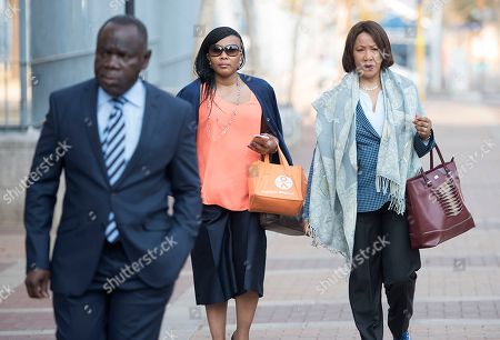 Makaziwe Mandela, right, and Mandela family members arrive at the Johannesburg Magistrates Court, in support of a 25-year-old grandson of former president Nelson Mandela who is accused of raping a minor at a Johannesburg bar