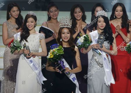 Lee Min-ji, Kim Ye-rin, Choi Myung-kyung Miss Korea Lee Min-ji, 24-year-old college student, bottom center, poses with first runner-up Kim Ye-rin and 2nd runner-up Choi Myung-kyung, left, after the 2015 Miss Korea Contest in Seoul, South Korea, . Lee will represent South Korea for this year's Miss Universe beauty pageant