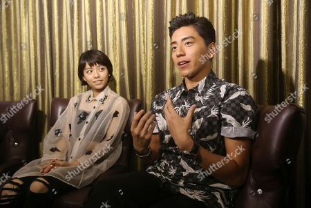 "Vivian Sung, Darren Wang On, Taiwanese actress Vivian Sung, left, and Taiwanese actor Darren Wang speak during an interview about their new film ""Our Times"" in Taipei, Taiwan"