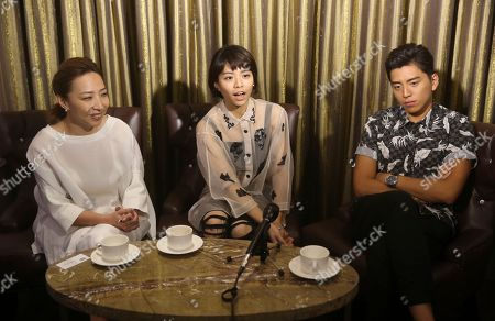"Frankie Chen Vivian Sung Darren Wang On, Taiwanese director Frankie Chen, left, Taiwanese actress Vivian Sung, center, and Taiwanese actor Darren Wang speak during an interview about their new film ""Our Times"" in Taipei, Taiwan"