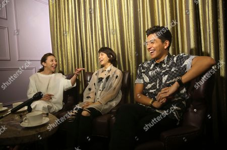 "Frankie Chen, Vivian Sung, Darren Wang On, Taiwanese director Frankie Chen, left, Taiwanese actress Vivian Sung, center, and Taiwanese actor Darren Wang speak during an interview about their new film ""Our Times"" in Taipei, Taiwan"