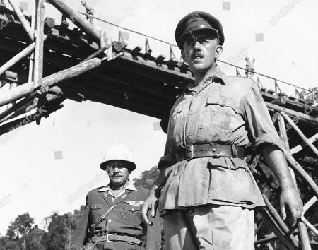 """Alec Guinness Actor Alec Guinness, right, stands in this scene from the film """"The Bridge on the River Kwai"""" during its production in Sri Lanka. Australian Rod Beattie, 67, arguably the world's authority on the Death Railway, has busted myths and inaccuracies that have accumulated around the railway"""
