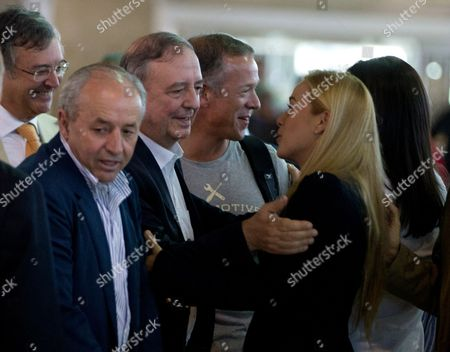 Dionisio Garcia Carnero, Lilian Tintori, Inaki Anasagasti, Andres Gil Spanish congressmen, Dionisio Garcia Carnero, left, Inaki Anasagasti, second from left, and Andres Gil are welcomed by Lilian Tintori, the wife of jailed opposition leader Leopoldo Lopez, at the Simon Bolivar airport in Maiquetia, near Caracas, Venezuela, . A group of lawmakers from Spain and Uruguay are starting a three-day visit to try to meet with some of the opposition's jailed members and hold meetings with community representatives