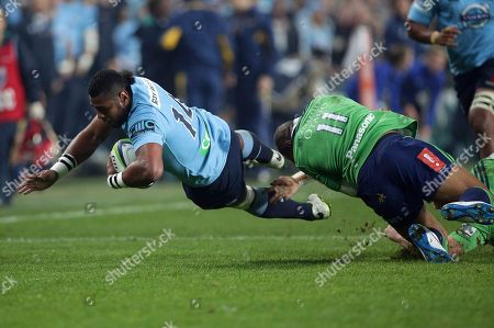 Taqele Naiyaravoro, Patrick Osborne Waratahs' Taqele Naiyaravoro, left, is tackled by Highlanders' Patrick Osborne during their Super Rugby semifinal match in Sydney
