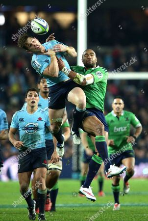 Patrick Osborne, Bernard Foley Highlanders' Patrick Osborne, right, and Waratahs' Bernard Foley clash as they leap high to take the ball during their Super Rugby semifinal match in Sydney