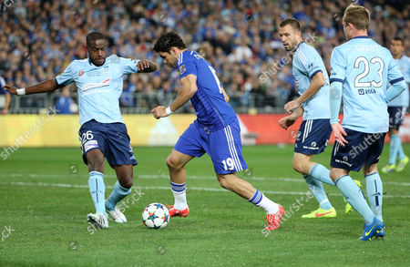 Chelsea's Diego Costa takes the ball past Sydney FC's Jacques Faty, left, Matthew Jurman and Rhyan Grant, right, during their friendly soccer match in Sydney