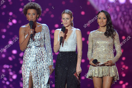 Hosts Arabella Kiesbauer, Mirjam Weichselbraun and Alice Tumler, from left, welcome the audience during the second semifinal of the Eurovision Song Contest in Austria's capital Vienna