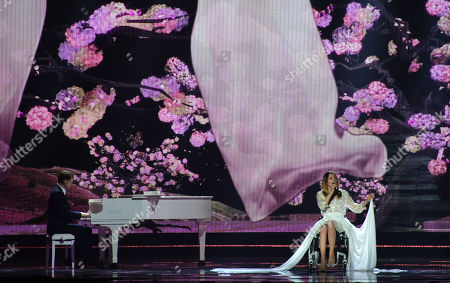 Stock Picture of Monika Kuszynska representing Poland performs the song 'In The Name Of Love' on stage during a dress rehearsal for the final of the Eurovision Song Contest in Austria's capital Vienna