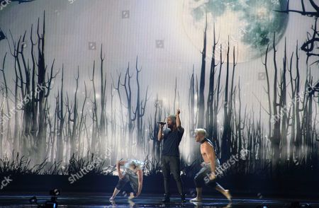 Elnur Huseynov representing Azerbaijan performs the song 'Hour Of The Wolf' on stage during a dress rehearsal for the final of the Eurovision Song Contest in Austria's capital Vienna