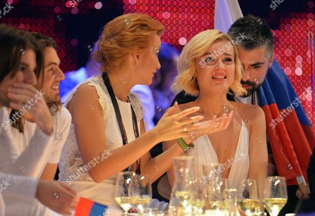 Polina Gagarina representing Russia, second right, reacts as the results start to come in during the final of the Eurovision Song Contest in Austria's capital Vienna