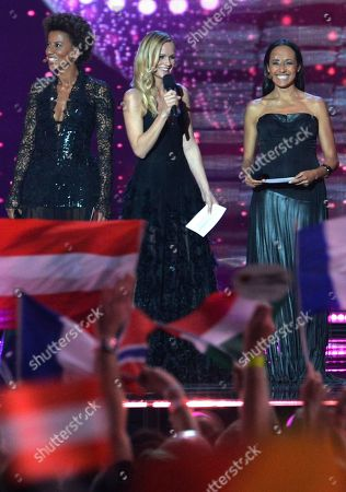 Stock Photo of Arabella Kiesbauer, Mirjam Weichselbraun and Alice Tumler, from left, host the final of the Eurovision Song Contest in Austria's capital Vienna