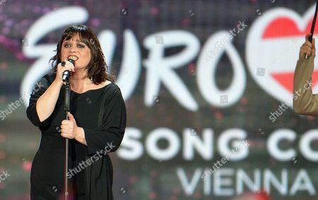 Stock Photo of Lisa Angell representing France performs the song 'N'oubliez Pas' during the final of the Eurovision Song Contest in Austria's capital Vienna