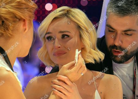 Polina Gagarina representing Russia, centre, reacts as the results start to come in during the final of the Eurovision Song Contest in Austria's capital Vienna