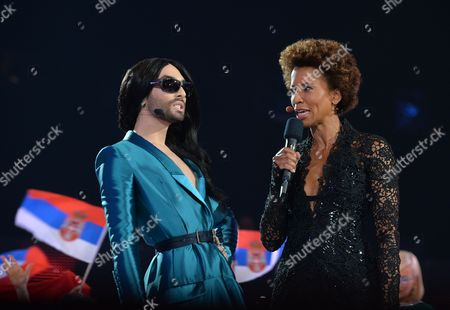 Conchita Wurst, who won the 2014 ESC for Austria, left, talks to co-host Arabella Kiesbauer during the final of the Eurovision Song Contest in Austria's capital Vienna