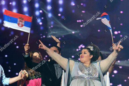 Stock Photo of Bojana Stamenov representing Serbia waves to fans as she is welcomed on stage prior to the final of the Eurovision Song Contest in Austria's capital Vienna