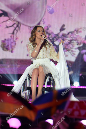 Stock Photo of Monika Kuszynska representing Poland performs the song 'In The Name Of Love' during the final of the Eurovision Song Contest in Austria's capital Vienna