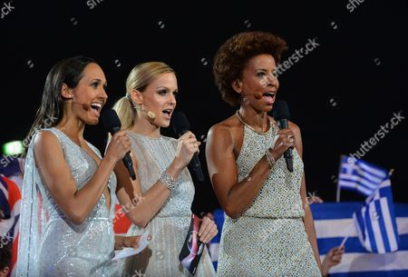 Co-hosts Alice Tumler, Mirjam Weichselbraun and Arabella Kiesbauer, from left. sing during a break in the final of the Eurovision Song Contest in Austria's capital Vienna