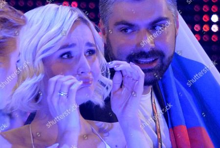 Stock Photo of Polina Gagarina, left, representing Russia cries as the results are announced during the final of the Eurovision Song Contest in Austria's capital Vienna