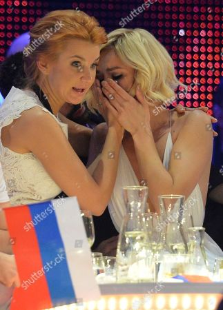 Polina Gagarina, right, representing Russia cries as the results are announced during the final of the Eurovision Song Contest in Austria's capital Vienna