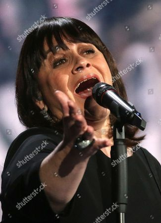 Lisa Angell representing France performs the song 'N'oubliez Pas' on stage during a dress rehearsal for the final of the Eurovision Song Contest in Austria's capital Vienna