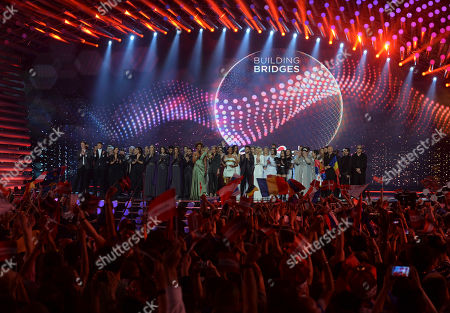 Hosts Arabella Kiesbauer, Mirjam Weichselbraun and Alice Tumler stand on stage with contestants, during the first semifinal of the Eurovision Song Contest in Austria's capital Vienna