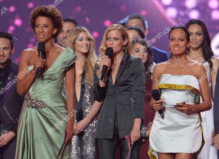 Stock Picture of Hosts Arabella Kiesbauer, Mirjam Weichselbraun and Alice Tumler, from left, are backdropped by the artists as they welcome the spectators during the first semifinal of the Eurovision Song Contest in Austria's capital Vienna