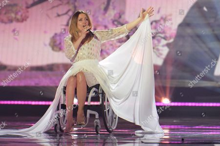 Poland's Monika Kuszynska performs the song 'In The Name Of Love' during a dress rehearsal for the second semifinal of the Eurovision Song Contest in Austria's capital Vienna