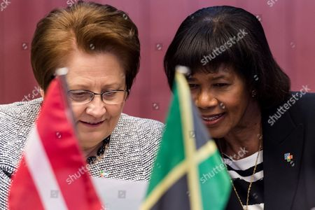 Latvian Prime Minister Laimdota Straujuma, left, speaks with Jamaica's Prime Minister Portia Simpson Miller during a round table meeting at an EU-CELAC summit in Brussels on . The Brussels summit will aim to boost trade and diplomatic ties with the region