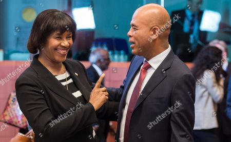 Jamaica's Prime Minister Portia Simpson Miller, left, speaks with Haiti's President Michel Joseph Martelly during a round table meeting at an EU-CELAC summit in Brussels on . The Brussels summit will aim to boost trade and diplomatic ties with the region