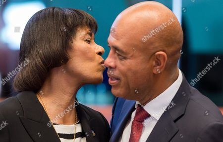 Stock Picture of Jamaica's Prime Minister Portia Simpson Miller, left, speaks with Haiti's President Michel Joseph Martelly during a round table meeting at an EU-CELAC summit in Brussels on . The Brussels summit will aim to boost trade and diplomatic ties with the region
