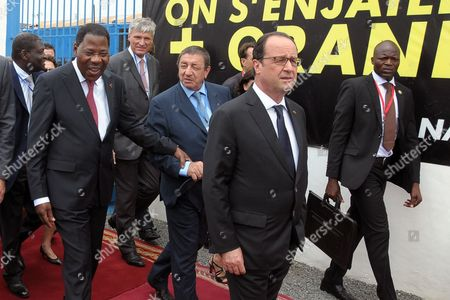 Francois Hollande French President Francois Hollande, second right, followed by Benin's President Yayi Boni, left, walks between meetings with government officials in Cotonou, Benin, . French President Francois Hollande has begun a two-day visit to Africa where he will hold talks with the leaders of Benin, Angola and Cameroon