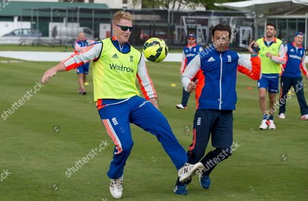 England's cricket player Ben Stokes, left, goes for the ball with batting coach Mark Ramprakash as they have a kick about with a soccer ball at Lord's cricket ground in London, . England and New Zealand will play a two test series starting with the first test at Lord's on May 21