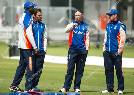 England's cricket player Adam Lyth, second right, gestures as he talks to Ian Bell, right, and batting coach Mark Ramprakash prior to a nets session at Lord's cricket ground in London, . England and New Zealand will play a two test series starting with the first test at Lord's on May 21