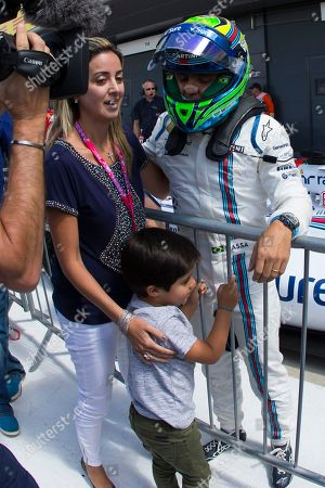 Stock Photo of Williams driver Felipe Massa of Brazil stands with his wife Rafaela Bassi and son Felipinho after qualification before the British Formula One Grand Prix at Silverstone circuit, Silverstone, England, . The British Formula One Grand Prix will be held on Sunday July 5